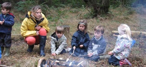 children around a campfire